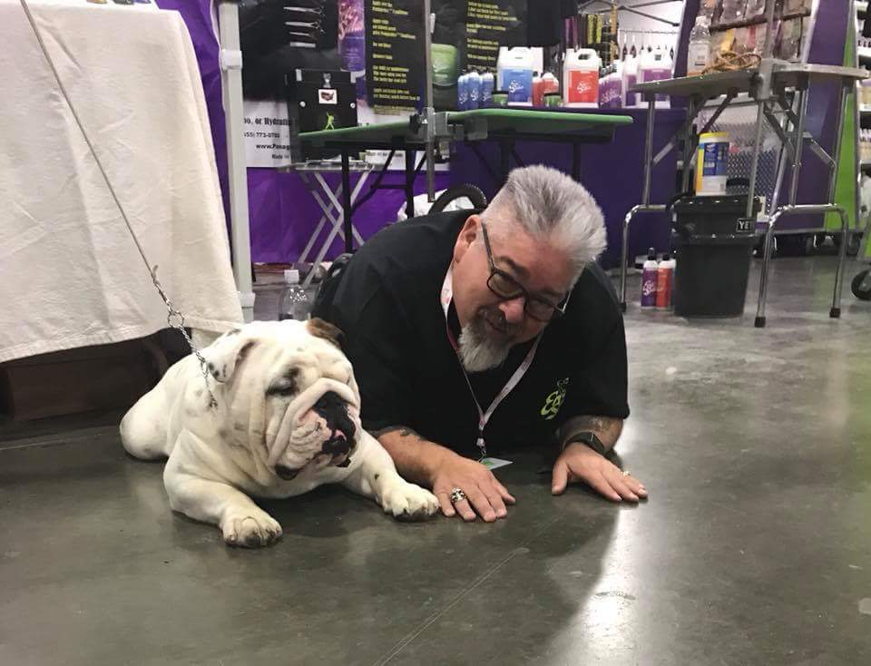 man on floor with bulldog
